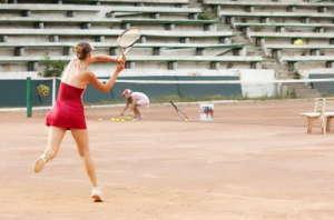 blond girl playing tennis