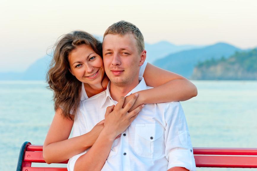 couple embracing near the sea