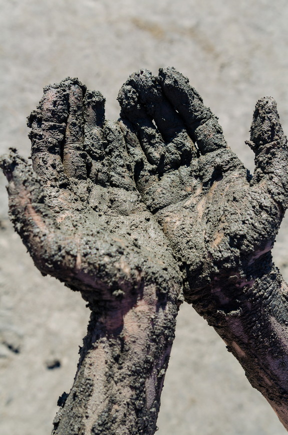 take a mud cure. healthy medical procedure. dirty hands