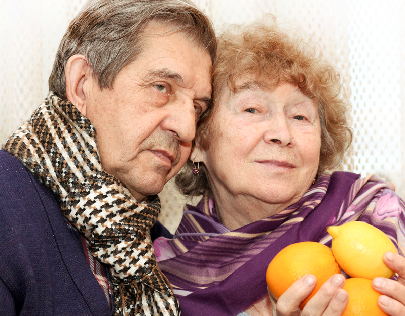 beautiful senior couple with fresh fruit
