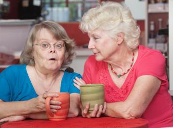 Concerned Friends Talking in Cafe