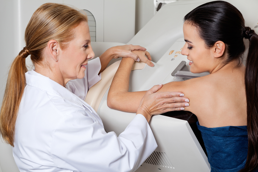 Doctor Assisting Patient During Mammography