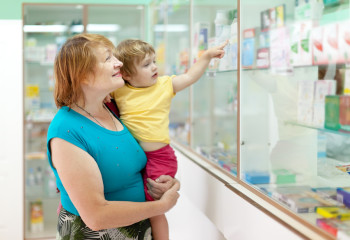 Mature woman with child at pharmacy