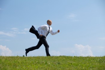 Businessman running in park