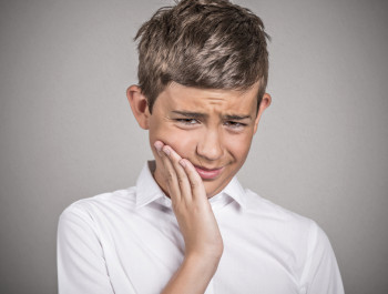 young man with sensitive tooth ache