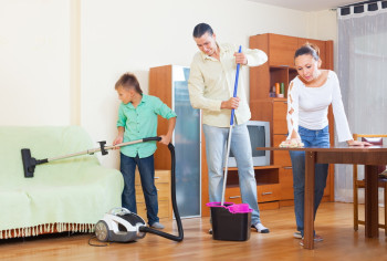 Family cleaning in living room