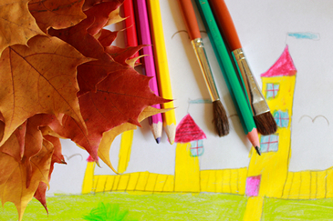 Children's drawing of house and autumn leaves
