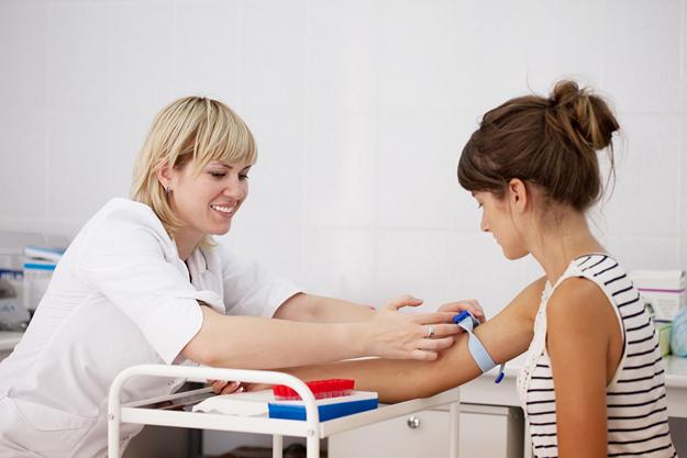 Nurse taking blood sample