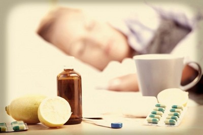 stock-image-woman-with-flu-in-bed_xxl-700x466